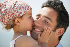 Man with his daughter, tender moment