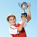 Kid holding a trophy